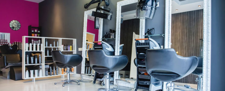 37997779 - interior of empty modern hair and beauty salon decorated in gray and fuchsia colors
