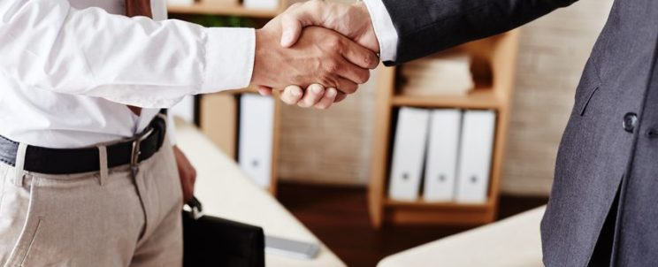 43007955 - businessmen handshaking after signing contract