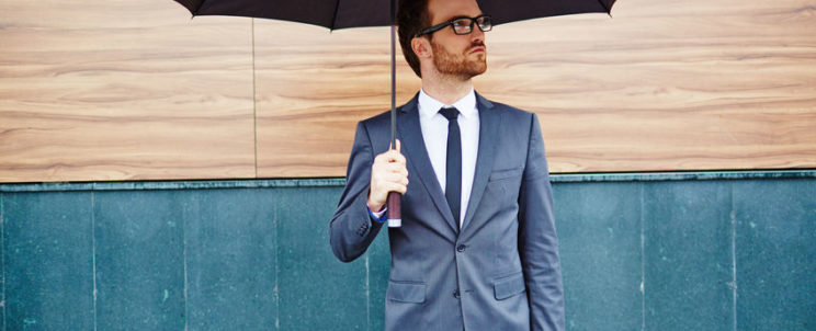 40513352 - young entrepreneur with briefcase standing outside under umbrella