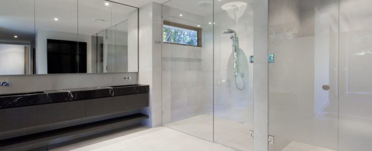15616603 - luxury bathroom with mirrors, sink, shower and toilet