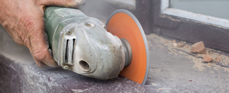 47206827 - the process of cutting concrete and bricks using grinders