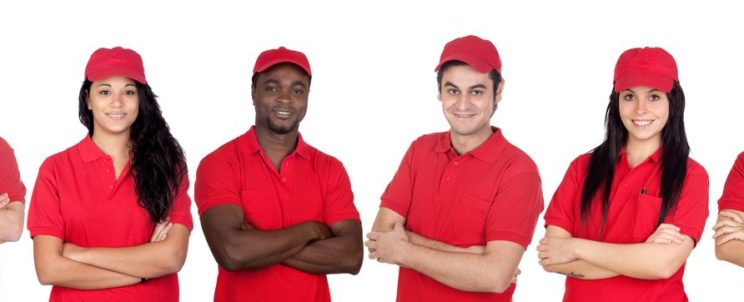 12373873 - team of workers with red uniform isolated over white background
