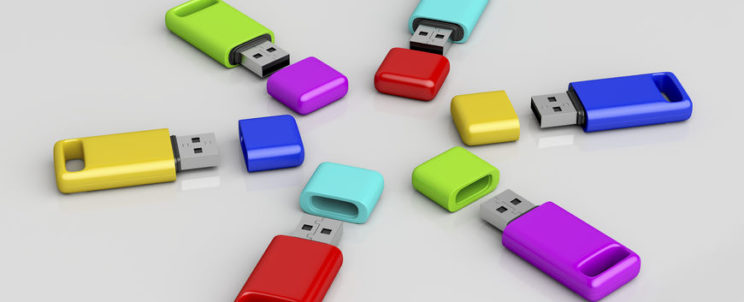 62559689 - group of usb memory sticks with different colors on shiny grey background