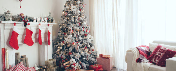 34257551 - beautiful holdiay decorated room with christmas tree with presents under it