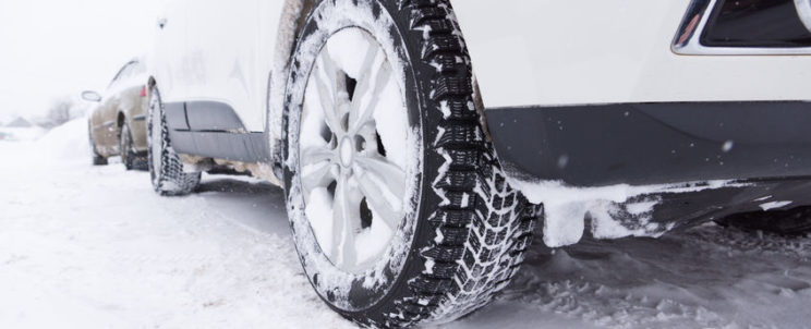 52128398 - cars with winter tires are on the snow-covered ground