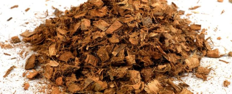 11932713 - garden wood chip mulch isolated against a white background
