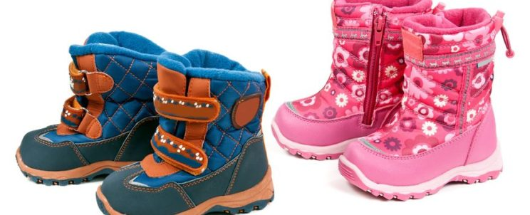 10408227 - two pairs of baby blue and pink boots isolated on white background