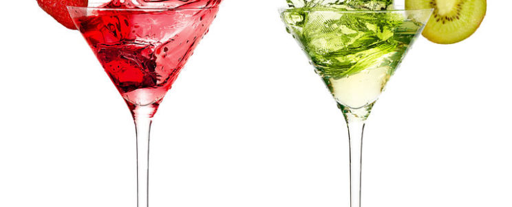 45037950 - two stylish cocktail glasses with fruity liquor splashing out, garnished with a ripe fresh strawberry and kiwi, closeup isolated on white. party concept.