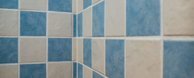 50563637 - decorative tiles in white and blue. bathroom geometric design