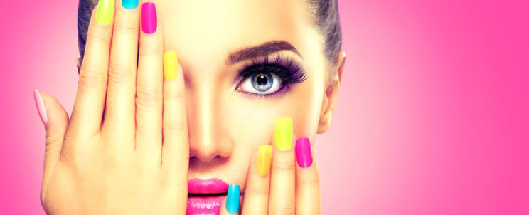 54596695 - beauty girl face with colorful nail polish