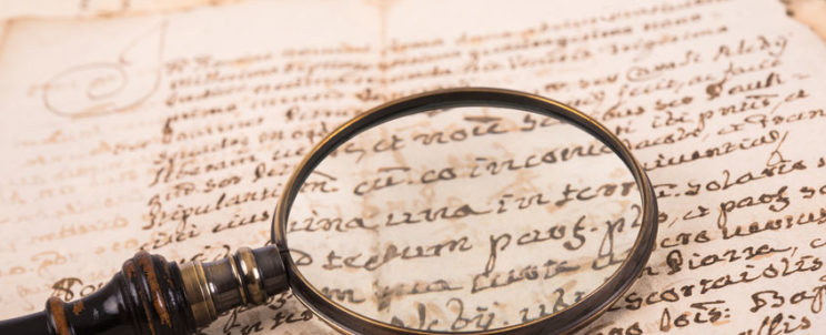 62317065 - old magnifying glass on old handwriting