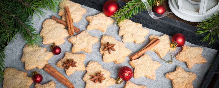48532721 - christmas cookies on a baking sheet with spices and decorations.